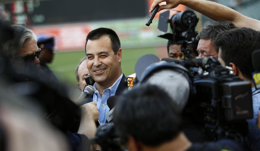 Dan Duquette, Baltimore Orioles executive vice president of baseball operations, speaks with members of the media before a baseball game against the Kansas City Royals in Baltimore, Monday, July 31, 2017. The Orioles announced Monday that they acquired infielder Tim Beckham from the Tampa Bay Rays. (AP Photo/Patrick Semansky)