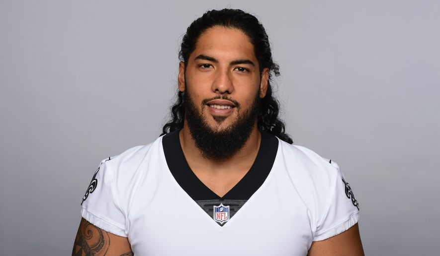 This is a 2017 file photo showing Kikaha Hau'oli of the New Orleans Saints NFL football team. Saints defensive end Hau'oli Kikaha appreciates the skepticism surrounding his ability to come back from a third left anterior cruciate ligament tear. The 2015 second-round draft pick, who set sack records at Washington, is nonetheless determined to reward the faith New Orleans has shown in him by keeping him around. (AP Photo/File)