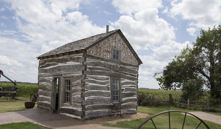 In this July 28, 2017 photo, a homesteader's log cabin is seen at the Homestead National Monument of America in Beatrice, Neb., one of the many places in Nebraska where the total solar eclipse on Aug. 21, 2017, can be seen. On Monday, July 31, 2017, Nebraska Gov. Pete Ricketts plans to announce a series of steps state agencies are taking to prepare for the solar eclipse, which is expected to draw visitors from around the world to the state. (AP Photo/Nati Harnik)