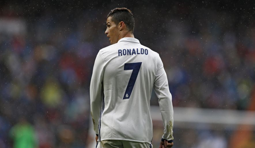 FILE- In this Saturday, April 29, 2017 file photo, Real Madrid's Cristiano Ronaldo looks on during the Spanish La Liga soccer match between Real Madrid and Valencia at the Santiago Bernabeu stadium in Madrid. Ronaldo has arrived at a Spanish court to answer questions as part of an investigation to determine whether the Real Madrid forward committed tax fraud. (AP Photo/Francisco Seco, File)