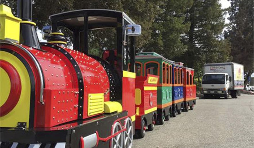 This undated photo provided by the Pleasant Hill Police Department shows a 25-foot electric passenger train that was stolen from a utility trailer in parking lot in Pleasant Hill, Calif., on Saturday night or early Sunday, July 30, 2017. The train owner said the trackless train makes regular appearances at festivals and parties. He is offering four hours of free train service as a reward. (Pleasant Hill Police Department via AP)
