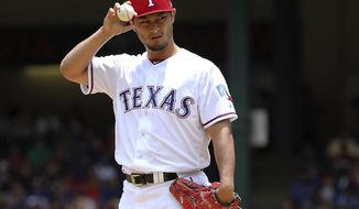 FILE - In this July 9, 2017, file photo, Texas Rangers starting pitcher Yu Darvish adjusts his hat as he works the first inning of a baseball game against the Los Angeles Angels, in Arlington, Texas. As the hours tick down to baseball's trade deadline, three standout pitchers remain at the center of attention. Sonny Gray, Justin Verlander and Yu Darvish each have the potential to help a contending team down the stretch, and if any of them are traded Monday, July 31, 2017, it would certainly spice up what has been a fairly pedestrian stretch of deals so far.  (AP Photo/Richard W. Rodriguez, File)