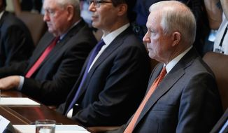 Attorney General Jeff Sessions listens as President Donald Trump speaks during a cabinet meeting in the Cabinet Room of the White House, Monday, July 31, 2017, in Washington. (AP Photo/Evan Vucci)
