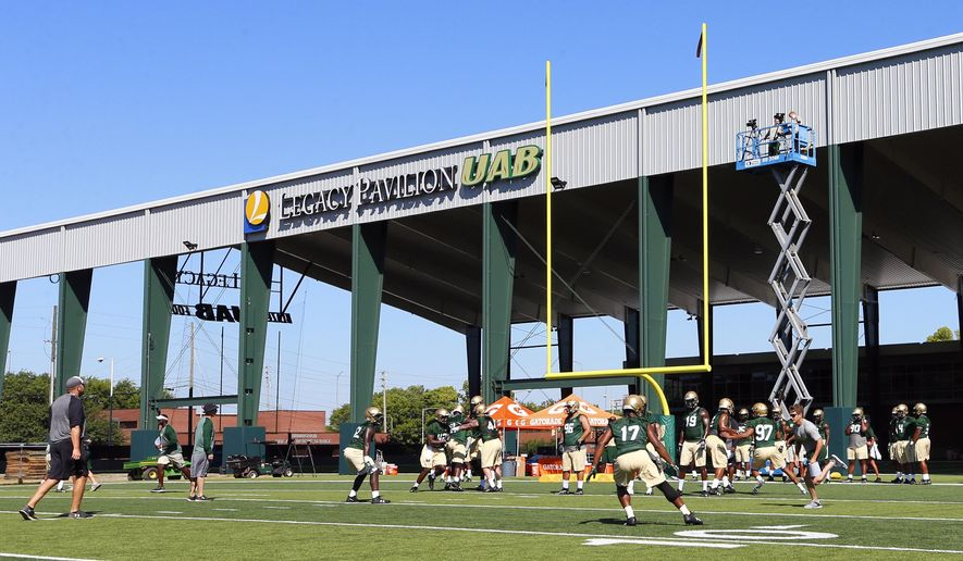 Players practice on the first day back as UAB's football program starts up again after two years, Monday, July 31, 2017, in Birmingham, Ala. (AP Photo/Butch Dill)