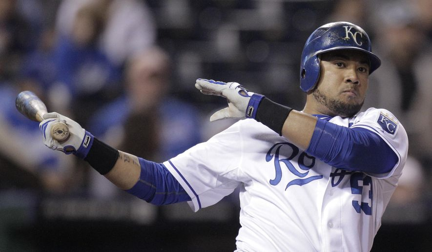 FILE - In this Sept. 16, 2011, file photo, Kansas City Royals' Melky Cabrera bats during the sixth inning of a baseball game against the Chicago White Sox, in Kansas City, Mo.  Trying to bolster their lineup for a playoff run and beating the trade deadline, the Kansas City Royals got outfielder Melky Cabrera from the Chicago White Sox on Sunday, July 30, 2017.The White Sox sent Cabrera and cash to Kansas City for a pair of Single-A pitchers, 22-year-old right-hander A.J. Puckett and 23-year-old lefty Andre Davis. (AP Photo/Charlie Riedel, File)