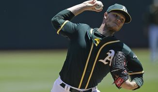 FILE - This July 19, 2017 file photo shows Oakland Athletics pitcher Sonny Gray working against the Tampa Bay Rays in the first inning of a baseball game in Oakland, Calif. Gray has been traded, Monday, July 31, 2017, to the Yankees from the Athletics for three prospects, boosting New York's starting rotation for an unexpected playoff run. (AP Photo/Ben Margot, file)