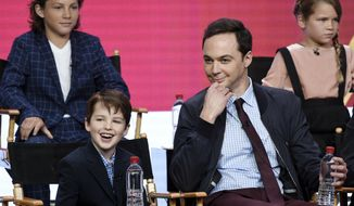 "Iain Armitage, front left, a cast member in the CBS series ""Young Sheldon,"" answers a question as executive producer/narrator Jim Parsons, front right, looks on during a panel discussion at the 2017 Television Critics Association Summer Press Tour on Tuesday, August 1, 2017, in Beverly Hills, Calif. Looking on in the back are cast members Montana Jordan, left, and Raegan Revord. (Photo by Chris Pizzello/Invision/AP)"