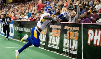 Washington Valor wide receiver T.T. Toliver, who played for the Tampa Bay Storm last season, holds the Arena Football League records for receptions and receiving. (Associated Press)