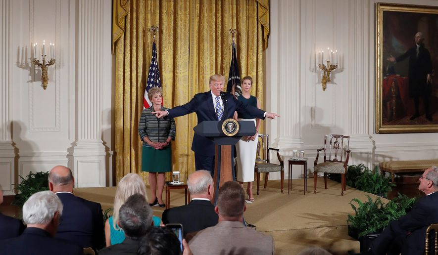 President Trump, flanked by Small Business Administration Administrator Linda McMahon and daughter Ivanka Trump, spoke about the economy with small-business owners on Tuesday. (Associated Press)