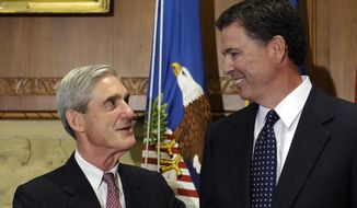 In this Sept. 4, 2013, file photo, then-incoming FBI Director James Comey talks with outgoing FBI Director Robert Mueller before Comey was officially sworn in at the Justice Department in Washington.  On May 17, 2017, the Justice Department said it is appointing Mueller as special counsel to oversee investigation into Russian interference in the 2016 presidential election. (AP Photo/Susan Walsh, File)