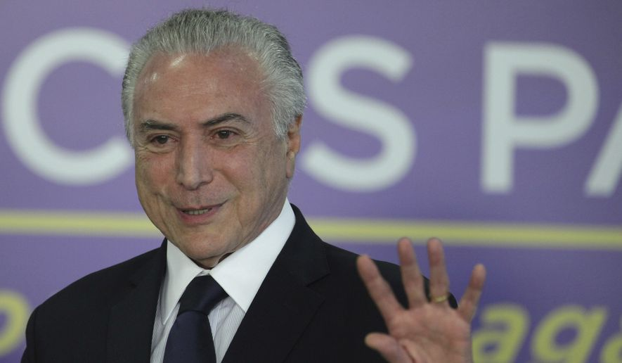 Brazil's President Michel Temer speaks during a ceremony at the Planalto Presidential Palace, in Brasilia, Brazil, Tuesday, Aug. 1, 2017. President Temer faces a congressional vote on his future Wednesday, a showdown coming in a month dreaded by leaders of Latin America's largest nation. August has seen Brazilian presidents impeached, resign and even kill themselves. (AP Photo/Eraldo Peres)