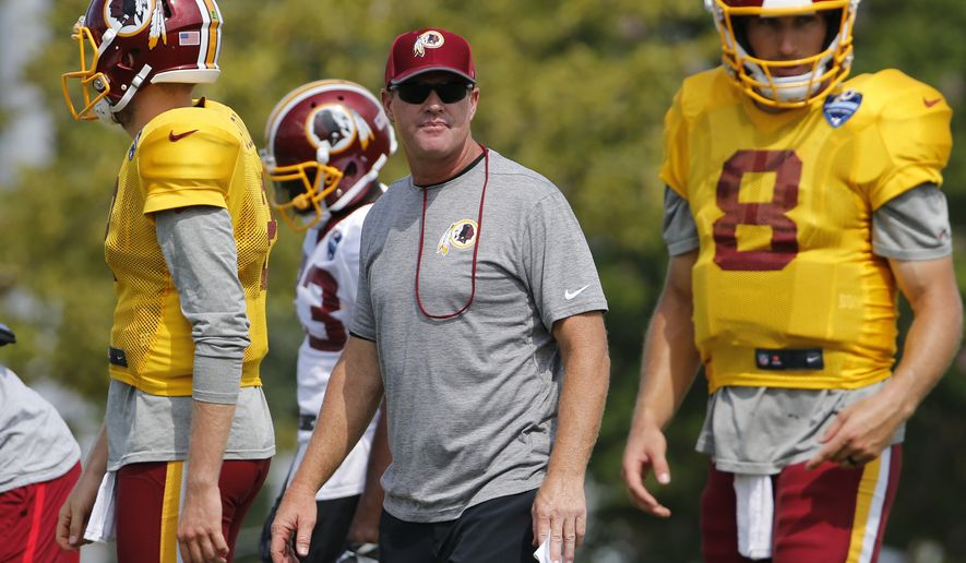 Washington Redskin head coach, Jay Gruden watches quarterback Kirk Cousins during practice at the Washington Redskins NFL training camp in Richmond, Va., Tuesday, Aug. 1, 2017. (AP Photo/Steve Helber)