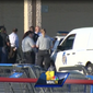 Baltimore County police at the scene of a fatal officer-involved shooting outside a Giant grocery store in Catonsville, Md., on August 1, 2017. The deceased allegedly stole detergent from the store and was confronted by the off-duty officer, who was moonlighting as a security guard, according to reports. Screen captured from a video posted by WBAL-TV.