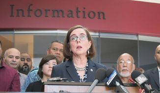 In this May 27, 2017, file photo, Oregon Gov. Kate Brown speaks at a news conference in Portland, Ore. Gov. Brown is authorizing the Oregon National Guard to deploy soldiers to help deal with an influx of tourists during August's total solar eclipse. (AP Photo/Gillian Flaccus, File)