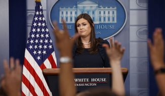 White House press secretary Sarah Huckabee Sanders listens to a question during the daily press briefing, Tuesday, Aug. 1, 2017, at the White House in Washington. (AP Photo/Evan Vucci)