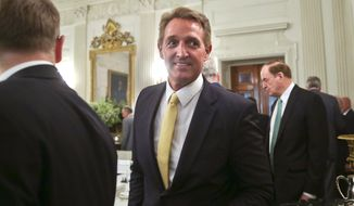 In this July 19, 2017, file photo, Sen. Jeff Flake, R-Ariz., center, walks to his seat as he attends a luncheon with other GOP senators and President Donald Trump in the State Dinning Room of the White House in Washington. (AP Photo/Pablo Martinez Monsivais, File)