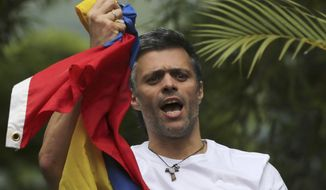 In this Saturday, July 8, 2017, file photo, Venezuela's opposition leader Leopoldo Lopez holds a national flag as he greets supporters outside his home in Caracas, Venezuela, following his release from prison and being placed under house arrest after more than three years in military lockup. Allies of two Venezuelan opposition leaders say Lopez and Antonio Ledezma have been taken by authorities from the homes where they were under house arrest. Video posted on the Twitter account of Lopez's wife early Tuesday, Aug. 1, shows a man being taken away from a Caracas home by state security agents. (AP Photo/Fernando Llano, File)