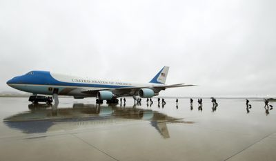 FILE - In this April 6, 2017, file photo, members of the White House press corps board Air Force One before the arrival of President Donald Trump at Andrews Air Force Base, Md. The Air Force, which has been looking for ways to lower the cost of new planes for Air Force One, confirmed on Tuesday, Aug. 1, that it is talking to Boeing about buying two jumbo jets that were ordered but never delivered to a now-defunct Russian airline. (AP Photo/Jose Luis Magana, File)
