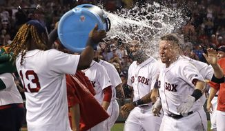 Boston Red Sox's Christian Vazquez, right, is doused with water by Hanley Ramirez after his walk-off, three-run home run in the bottom of ninth inning of a baseball game against the Cleveland Indian at Fenway Park, Tuesday, Aug. 1, 2017, in Boston. The Red Sox won, 12-10. (AP Photo/Charles Krupa)