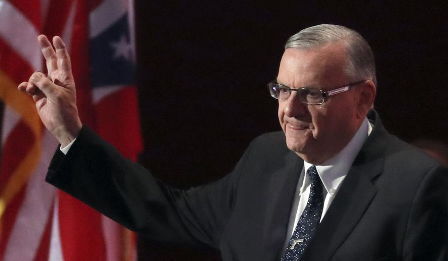 In this July 21, 2016, file photo, Sheriff Joe Arpaio of Arizona walks on the stage to speak during the final day of the Republican National Convention in Cleveland. (AP Photo/Paul Sancya, File)