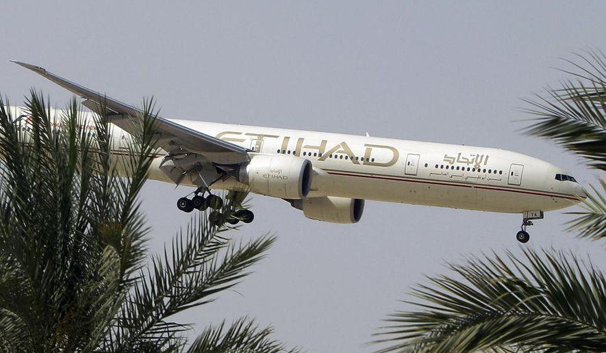 n this Sunday, May 4, 2014 file photo, an Etihad Airways plane prepares to land in Abu Dhabi Airport, United Arab Emirates. (AP Photo/Kamran Jebreili, File)