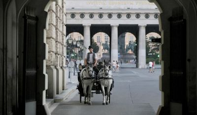 In this photo taken June 26, 2017 a Fiaker coach drives through the old town in Vienna, Austria. Officials have imposed a ban on horse carriage rides in the Austrian capital, Tuesday, Aug. 1, 2017, due to searing temperatures. A city ordinance gives carriage horses the day off once temperatures reach 35 degrees Celsius (95 Fahrenheit.) (AP Photo/Ronald Zak)