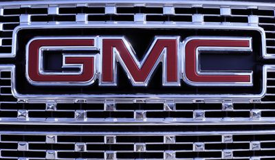 In this April 25, 2017, photo, a GMC truck sits in a General Motors dealer's lot in Nashville, Tenn. U.S. sales of new cars and trucks were expected to show a decline in July 2017 as consumers pulled back on purchases and waited for Labor Day deals. July likely marked the seventh straight month of declines in a peaking market. (AP Photo/Mark Humphrey)