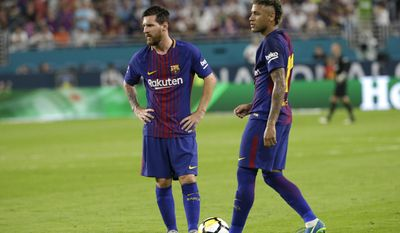 Barcelona's Lionel Messi, left, and Neymar, right, stand on the field during a break in the action during the first half of an International Champions Cup soccer match against Real Madrid, Saturday, July 29, 2017, in Miami Gardens, Fla. (AP Photo/Lynne Sladky)