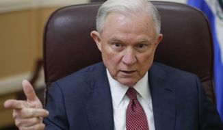 In a Friday, July 28, 2017 file photo, U.S. Attorney General Jeff Sessions speaks during his interview with The Associated Press, at the National Police Headquarters in San Salvador, El Salvador. Sessions addressed the National Organization of Black Law Enforcement Executives, in Atlanta on Tuesday, Aug. 1, 2017. He told members that they deserve the support of every American, and said the Trump administration stands behind them.  (AP Photo/Pablo Martinez Monsivais)