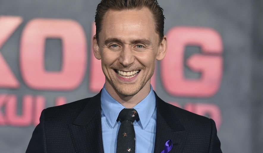"""FILE - In this Wednesday, March 8, 2017 file photo, Tom Hiddleston arrives at the Los Angeles premiere of """"Kong: Skull Island"""" at the Dolby Theatre. Thor"""" star Tom Hiddleston is to play Hamlet on the London stage _ but fans will need a bit of luck to get a ticket. Hiddleston is set to play the moody Danish prince for three-weeks in September at the Royal Academy of Dramatic Art's 180-seat theater, it was announced on Tuesday, Aug. 1, 2017. (Photo by Jordan Strauss/Invision/AP, File)"""