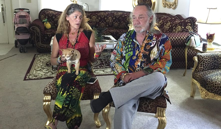 Heidi and Charles Edward Lepp sit in their Sacramento, Calif., home Tuesday, Aug. 1, 2017, discussing a shooting at the cannabis farm affiliated with their Rastafarian church in Dobbins, Calif., earlier in the day. Heidi Lepp received a call Tuesday morning that a worker at the Northern California farm was pulling up plants and was armed, prompting her to call the Yuba County Sheriff's Department. (AP Photo/Kathleen Ronayne)
