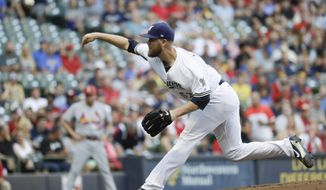 Milwaukee Brewers starting pitcher Jimmy Nelson throws during the first inning of a baseball game against the St. Louis Cardinals Tuesday, Aug. 1, 2017, in Milwaukee. (AP Photo/Morry Gash)