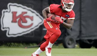 FILE - In this May 24, 2017, file photo, Kansas City Chiefs running back Kareem Hunt (27) participates in a drill during the team's organized team activity at its NFL football training facility, in Kansas City, Mo. Ask anyone working with the Chiefs' offense who has been turning heads these days and chances are Kareem Hunt's name will float to the surface. (AP Photo/Charlie Riedel, File)