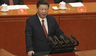 Chinese President Xi Jinping speaks during a ceremony to commemorate the 90th anniversary of the founding of the People's Liberation Army at the Great Hall of the People in Beijing, Tuesday, Aug. 1, 2017. (AP Photo/Andy Wong, Pool)
