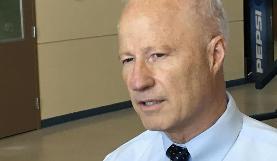 Colorado Republican Rep. Mike Coffman speaks to reporters before holding a constituent town hall in Brighton, Colo., on Tuesday, Aug. 1, 2017. Coffman called for a bipartisan effort on health care after the GOP-led Congress failed to produce a new health care law. (AP Photo/Jim Anderson)
