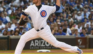 Chicago Cubs starting pitcher Jon Lester (34) delivers during the first inning of a baseball game against the Arizona Diamondbacks on Tuesday, Aug. 1, 2017, in Chicago. (AP Photo/Matt Marton)