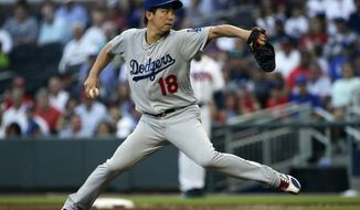 Los Angeles Dodgers starting pitcher Kenta Maeda (18) works against the Atlanta Braves in the first inning of a baseball game Tuesday, Aug. 1, 2017, in Atlanta. (AP Photo/John Bazemore)