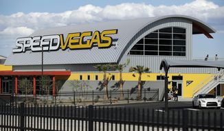 FILE - In this March 21, 2017, file photo, people stand outside of SpeedVegas in Las Vegas. Nevada safety officials are recommending fines of $16,000 against the tourist-oriented exotic auto track where a Canadian man and an instructor died in a fiery crash of a high-performance Lamborghini in February. The state Occupational Safety and Health Administration said SpeedVegas had a substandard fire and safety plan and failed to properly train employees in fire suppression. (AP Photo/John Locher, File)