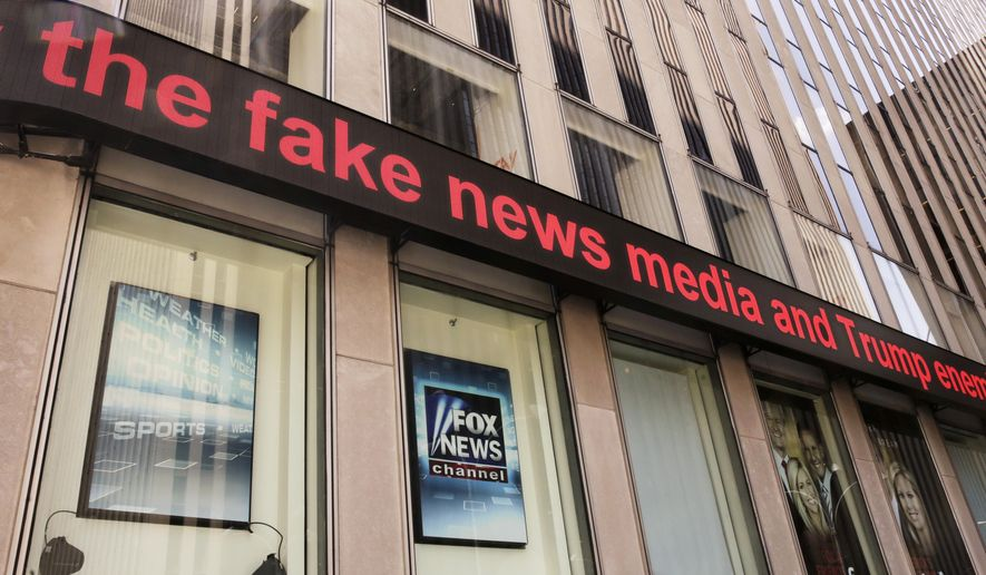 News headlines scroll above the Fox News studios in the News Corporation headquarters building in New York on Tuesday, Aug. 1, 2017. (AP Photo/Richard Drew) **FILE**