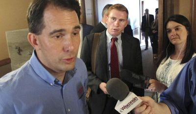 """Wisconsin Gov. Scott Walker speaks to the media Tuesday, Aug. 1, 2017, in Madison, Wis. Walker said he does not anticipate there will be """"major changes"""" to a bill that would extend $3 billion in taxpayer incentives to lure electronics manufacturer Foxconn to build a factory in the state. (AP Photo/Scott Bauer)"""