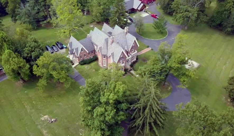 This image provided by WDRB-TV and taken with a WDRB drone camera shows Kentucky Gov. Matt Bevin's home on Tuesday, Aug. 1, 2017, in Louisville, Ky. Local officials have inspected the home of Kentucky's Republican governor as part of an appeal of the property's value. (WDRB Drone Camera via AP)