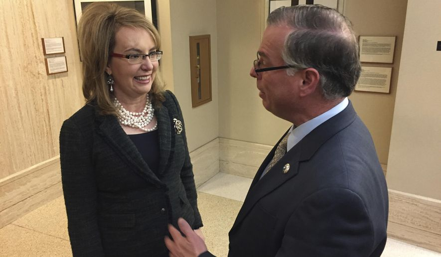 FILE--In this Feb. 22, 2017, file photo, former U.S. Congresswoman and shooting survivor Gabrielle Giffords, left, talks with Democratic New Mexico Sen. Daniel Ivey-Soto in Santa Fe, N.M. A national gun-safety group on Tuesday, Aug. 1, 2017, stepped up pressure in New Mexico against proposed U.S. firearms legislation that would make states recognize concealed handgun permits from other states.(AP Photo/Morgan Lee, file)