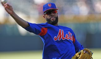 New York Mets shortstop Amed Rosario throws during batting practice for the team's baseball game against the Colorado Rockies on Tuesday, Aug. 1, 2017, Denver. (AP Photo/David Zalubowski)
