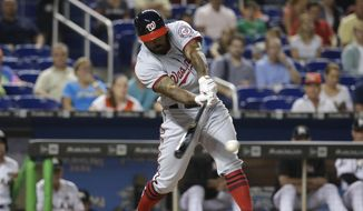 Washington Nationals' Howie Kendrick hits a single during the first inning against the Miami Marlins in a baseball game Tuesday, Aug. 1, 2017, in Miami. (AP Photo/Lynne Sladky)