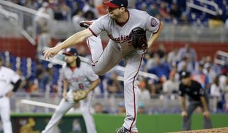 Washington Nationals starting pitcher Max Scherzer follows through on a delivery during the first inning of the team's baseball game against the Miami Marlins, Tuesday, Aug. 1, 2017, in Miami. (AP Photo/Lynne Sladky)