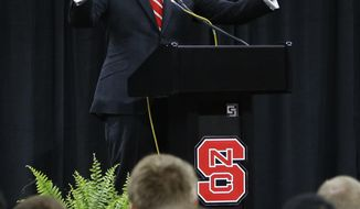 FILE - In this March 19, 2017, file photo, new North Carolina State head basketball coach Kevin Keatts gestures during an introductory press conference in Raleigh, N.C. Keatts will get a look at how much his new players have learned during an 11-day trip to Italy. (Ethan Hyman/The News & Observer via AP, File)