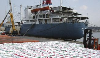 In this May 23, 2005, file photo, a North Korea cargo ship Paik Du San cast anchor as the bags of fertilizer are loading its at Ulsan port in Ulsan, South Korea. North Korea has been condemned and sanctioned for its nuclear ambitions, yet has still received food, fuel and other aid from its neighbors and adversaries for decades. How does the small, isolated country keep getting what it wants and needs to prevent its collapse? (AP Photo/ Lee Jin-man, File)