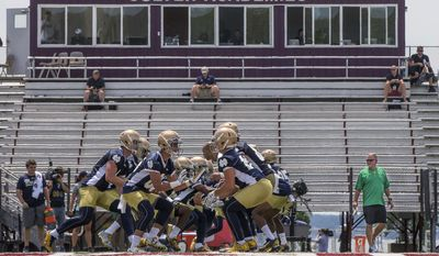 Notre Dame coach Brian Kelly, right, watches as players run blocking drills during the first day of fall practice for the NCAA college football team Tuesday, Aug. 1, 2017,  in Culver, Ind. (Robert Franklin/South Bend Tribune via AP)