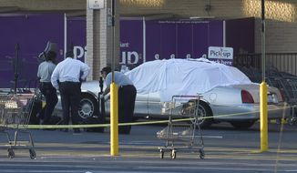 Baltimore County police investigate a fatal shooting outside a store Tuesday, Aug. 1, 2017, in Catonsville, Md. Authorities said a police officer working security at the store fatally shot a man suspected of shoplifting during a confrontation. (Jeffrey F. Bill/The Baltimore Sun via AP)