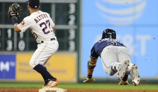 Tampa Bay Rays' Evan Longoria, right, slides into second for a double as Houston Astros second baseman Jose Altuve (27 waits for the throw during the ninth inning of a baseball game, Tuesday, Aug. 1, 2017, in Houston. The double completed the cycle for Longoria. (AP Photo/Eric Christian Smith)